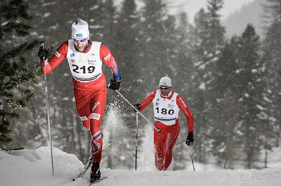 Two athletes at the Interbancario XC skiing race, Engadine, Switzerland.