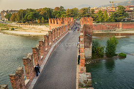VERONA, ITALY - OCTOBER 27, 2017: Adige River and fortified bridge Verona Castel Vecchio Bridge or Ponte Scaligero. Verona, I...