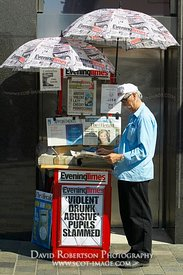 Image - Evening Times newspaper street seller, Glasgow, Scotland.