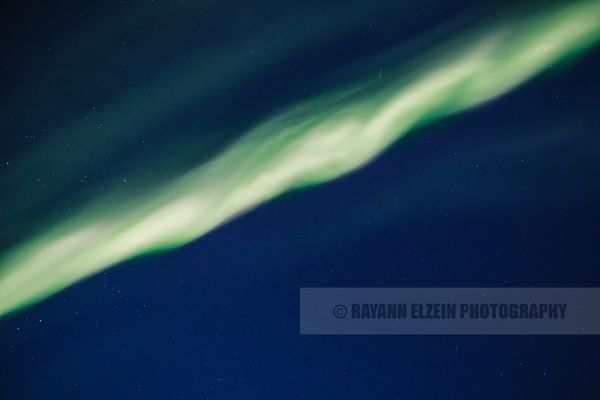 Aurora corona against blue sky straight overhead in Lapland