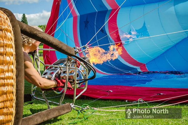 Hot air balloon inflation. Firing the burners to warm the air in the envelope.