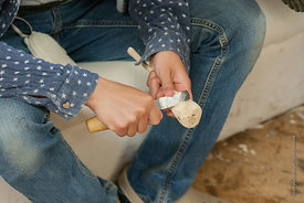 #73002,  Girl whittling a spoon to give to her father, carpentry workshop, Summerhill School, Leiston, Suffolk. The school wa...