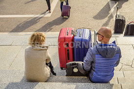 VENICE, ITALY - OCTOBER 26, 2017: Two travellers with luggage outside the Santa Lucia railway station in Venice.