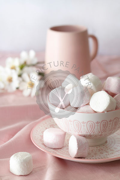 Pink and white marshmallows in a bowl.