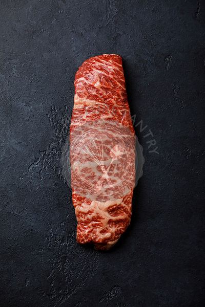 Raw fresh marbled meat Steak Wagyu beef on dark background