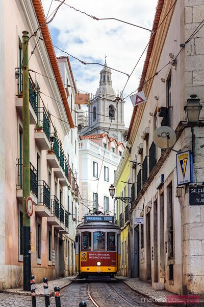 Tram in a narrow street in the old town, Lisbon, Portugal