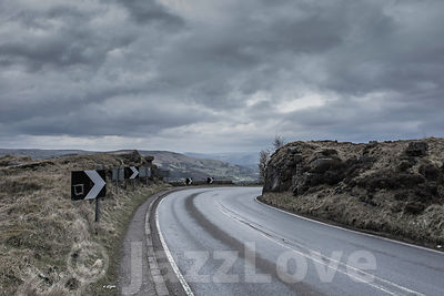 Rural road in rough terrain of Derbyshire,UK.