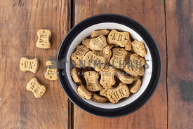 dog treats in bowl and on wooden table
