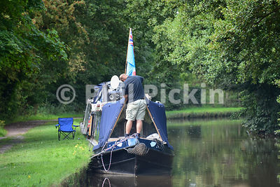Man working on his narrowboat