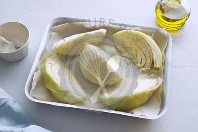 Cabbage wedges with spices and olive oil