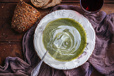 Broccoli soup with yogurt served in a vintage plate