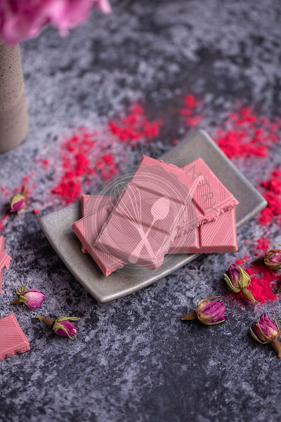 Ruby chocolate on a grey background