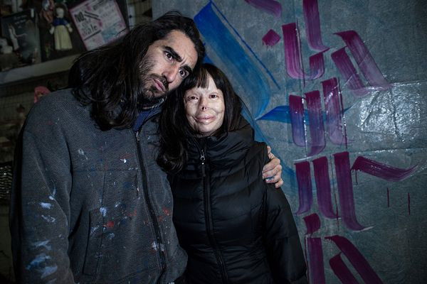 Valentina Pitzalis (R) with artist Ivan Tresoldi in front of the artwork he made with her name.