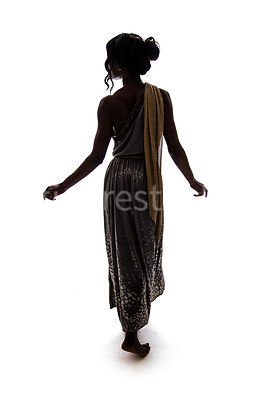 A silhouette of a barefoot Roman woman in a dress – shot from eye level.