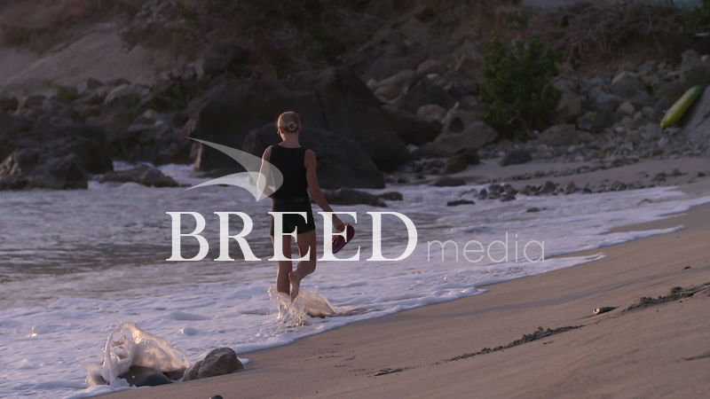 BMS001_014_HD_25fps_Woman_walking_along_beach_01