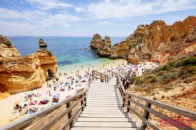 Boardwalk to crowded beach, Algarve, Portugal