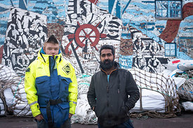 Geordie and Michael, deck hands, in front of Mallaig smokehouse.