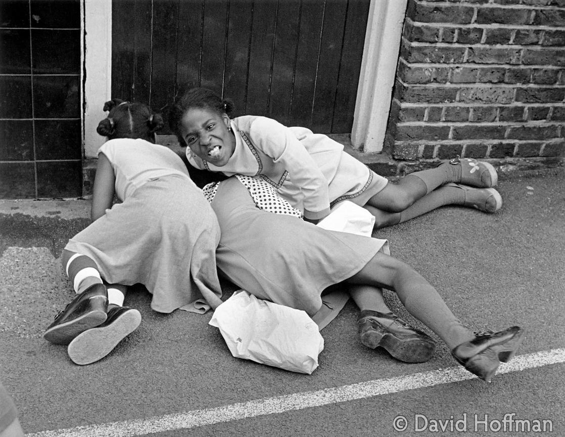 Girls fighting in the playground on a summer playscheme at Cayley School, Stepney 1976.