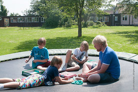 "#73098,  Philipp Klaus, holding an English class on the trampoline using the ""Upwords"" game, Summerhill School, Leiston, Suff..."
