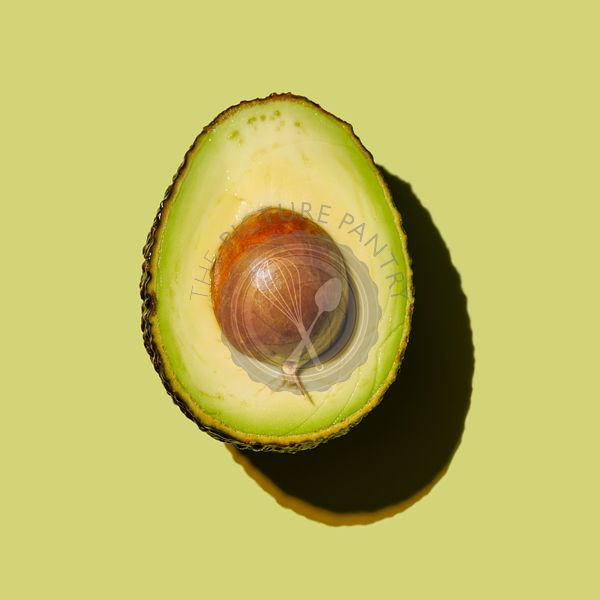 Avocado on green background