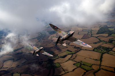 Spitfires among low clouds