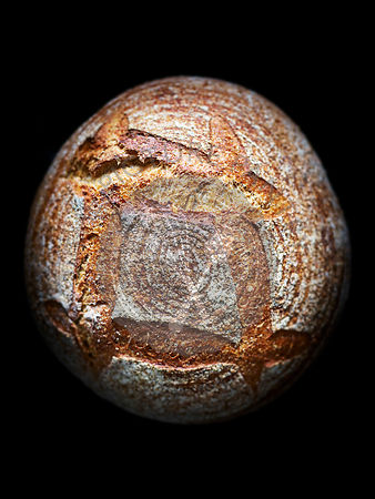 A close up photograph of a loaf of artisan bread