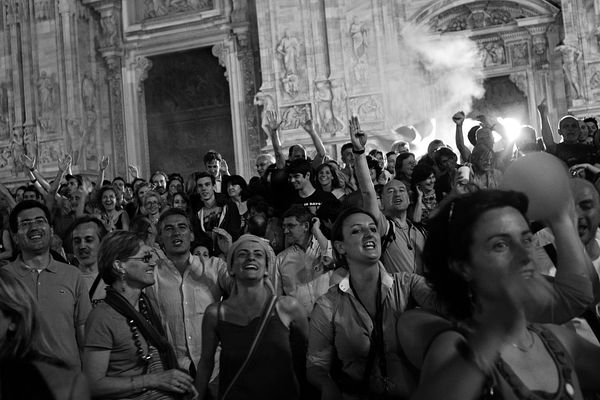 Pisapia's supporters filled the Piazza del Duomo completely; people singing with the artists performing at the square.