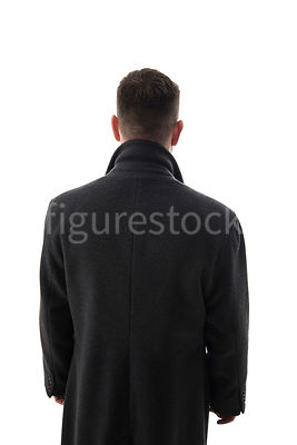 A Figurestock image of a mystery man looking away, in a long black winter coat – shot from eye level.