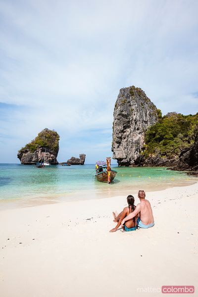 Adult couple relaxing at the beach, Phi Phi islands, Thailand